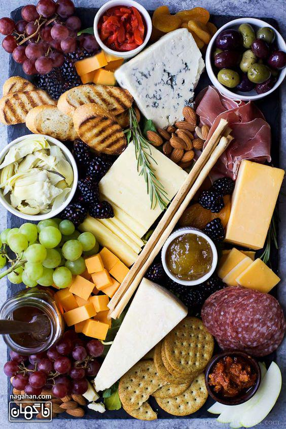 میز مزه با پنیر های متنوع و مربا و عسل
