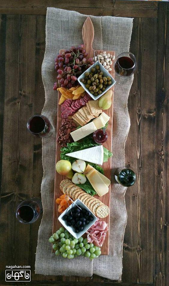 میز مزه با انواع پنیر و کالباس و اسنک و مربا
