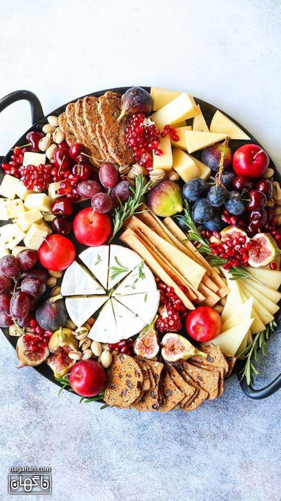 میز مزه با پنیر های متنوع و مربا و انجیر