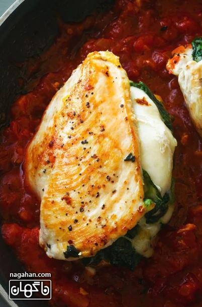 آموزش تصویری مرغ شکم پر با پنیر موزارلا و اسفناج سایت ناگهان