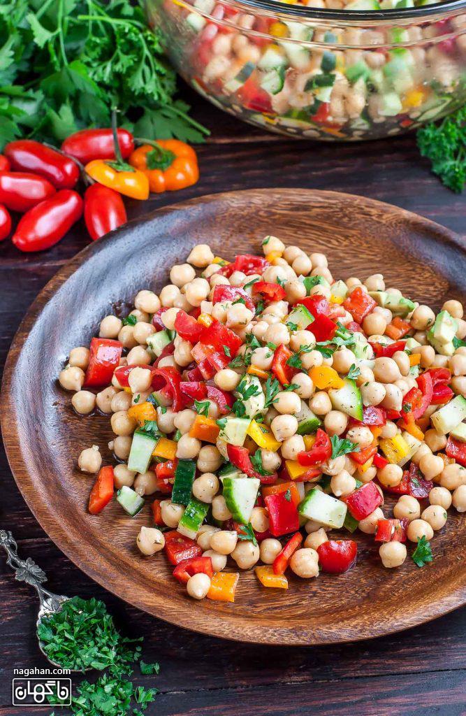 عکس سالاد نخود یونانی پیش غذای رژیمی و گیاهی مدیترانه ای