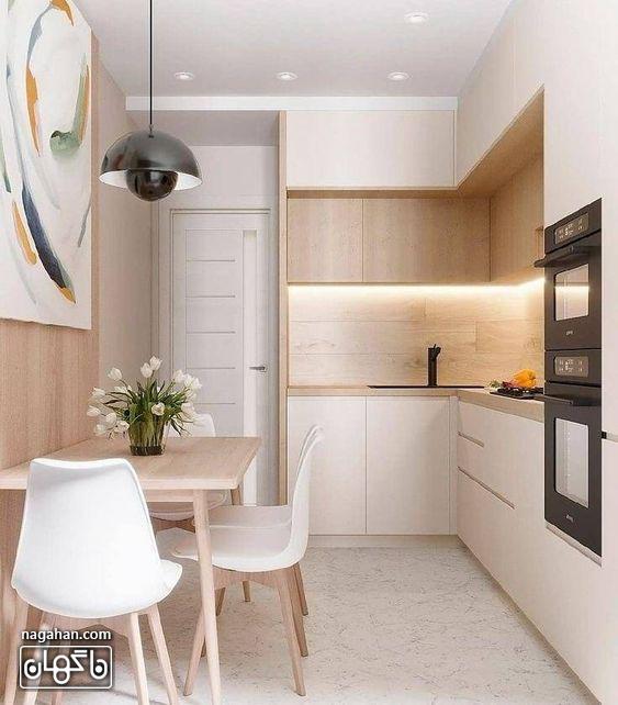 بین کابینتی و کابینت و میزناهار خوری کوچکدر آشپزخانه کوچک مدرن