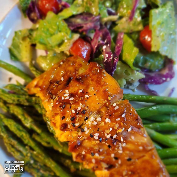 طرز تهیه ماهی قزل آلا با سس سیر و کره خوشمزه و آساندر کمتر از نیم ساعت
