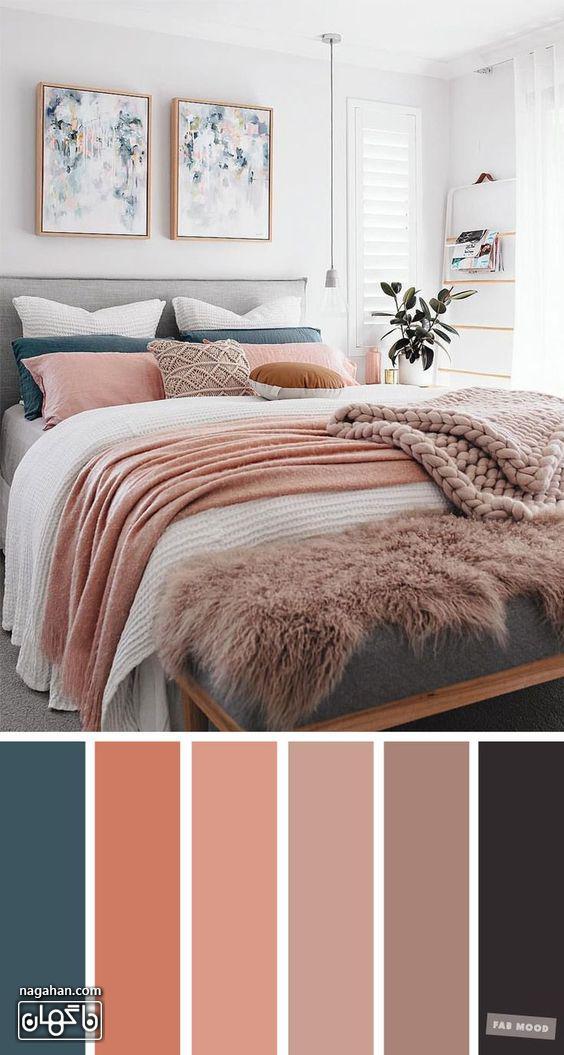 عکس دکوراسیون اتاق خواب با ترکیب رنگ طیف صورتی ملایم و تابلو نقاشی آبستره