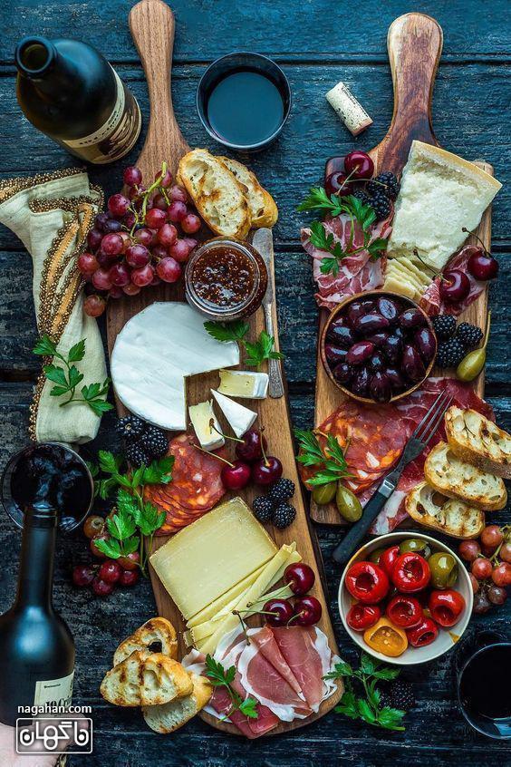 میز مزه با انواع پنیر و اسنک و میوه و مربا